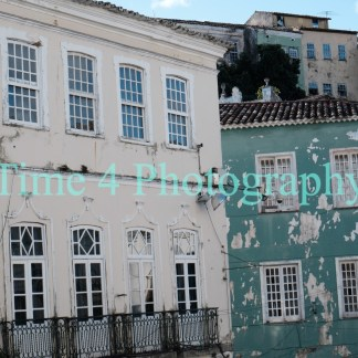 Old houses of the portuguese colonial period in Salvador Brasil, each facade has a different color and color is already fading.