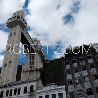 The famous Lacerda Elevator, in the city of Salvador da Bahia, as seen from below, against a blue sky with white clouds