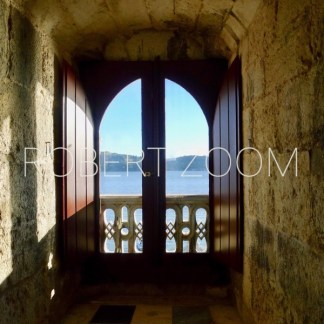 A window inside the famous Belem Tower (Torre de Belem )in Lisbon, Portugal, looks at the see down far below.
