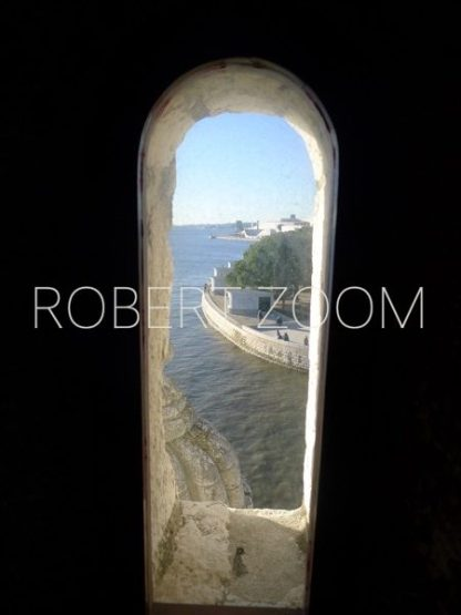 A high window inside the famous Belem Tower (Torre de Belem )in Lisbon, Portugal, looks at the see down far below.