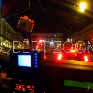 Downtown Lisbon at night, seen from inside a taxi