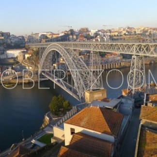 The Dom Luis 1 bridge over the Douro river in Porto. Both river and sky are blue