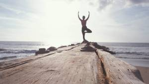 Yoga position on wooden walk