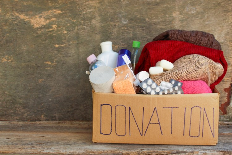 Donation box with clothes, living essentials