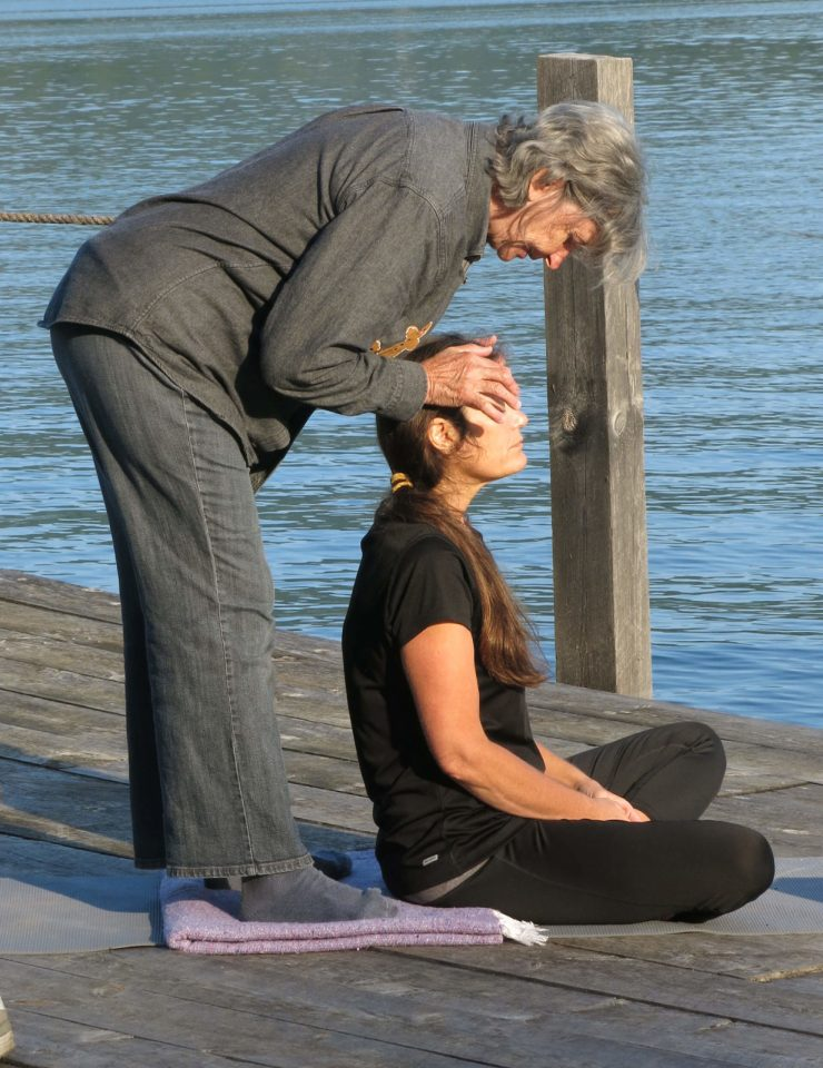 Yoga on the dock of Wiawaka Holiday House on Lake George led by Kathleen Fisk. Attended by Robin Botie of Ithaca, New York, and other bereaved mothers from all over New York.