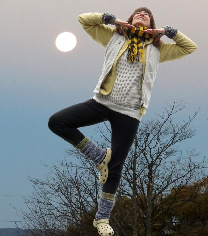 Robin Botie of ithaca, New York, tries to do the tree yoga stance in a photoshopped moonscape.