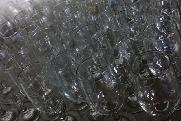 Robin Botie of Ithaca, New York, photographs wineglasses lined up for Cornell's Adult University wine tasting course.