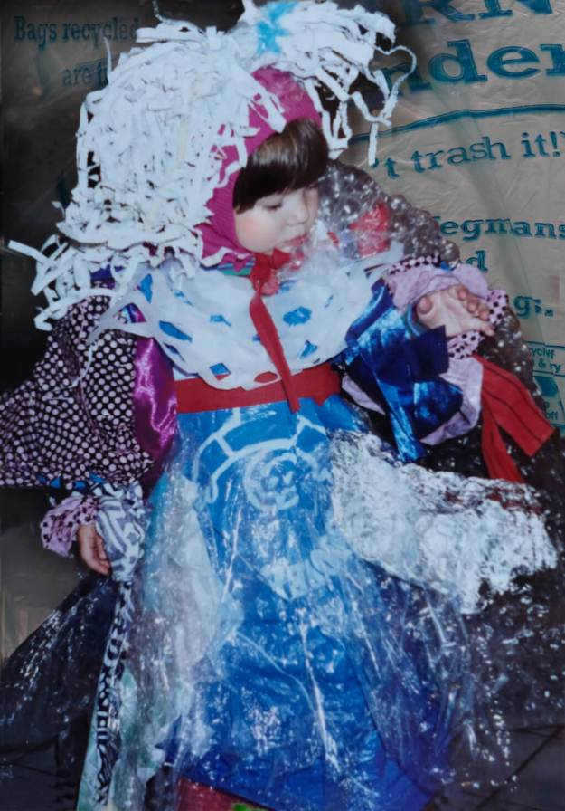 In Photoshop, Robin Botie of Ithaca, New York, restores a picture of three-year-old Marika Warden as a garbage monster, wearing a dress made of plastic bags.