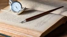 Watch, fountain pen, book