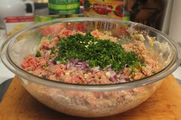 Combine chopped veggies with meat mixture.