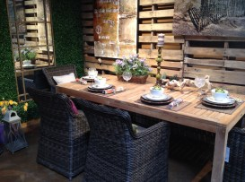 Outdoor dining area with wicker chairs and comfortable cushions
