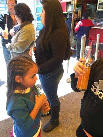 Aliyah and Isaac drinking a soda