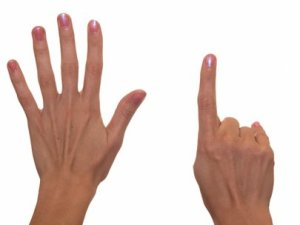 Woman holding up six fingers
