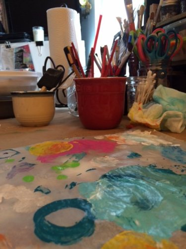 paint palette and brushes on studio table