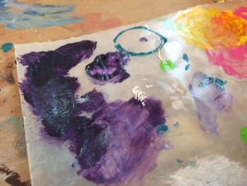 Purple paint on a palette in the studio