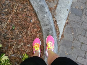 pink running shoes, as seen from the wearer