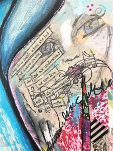 mixed media art with a woman's face blended in with 'found words' by RobinLK Studios