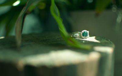 Rounded split shank blue diamond halo engagement ring