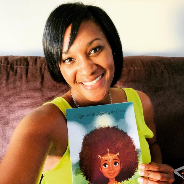 Author Danielle Cotton with her book, Tajja and the Legend of the Queens