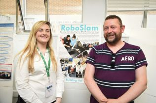 Claragh and Damon at Living Knowledge conference poster