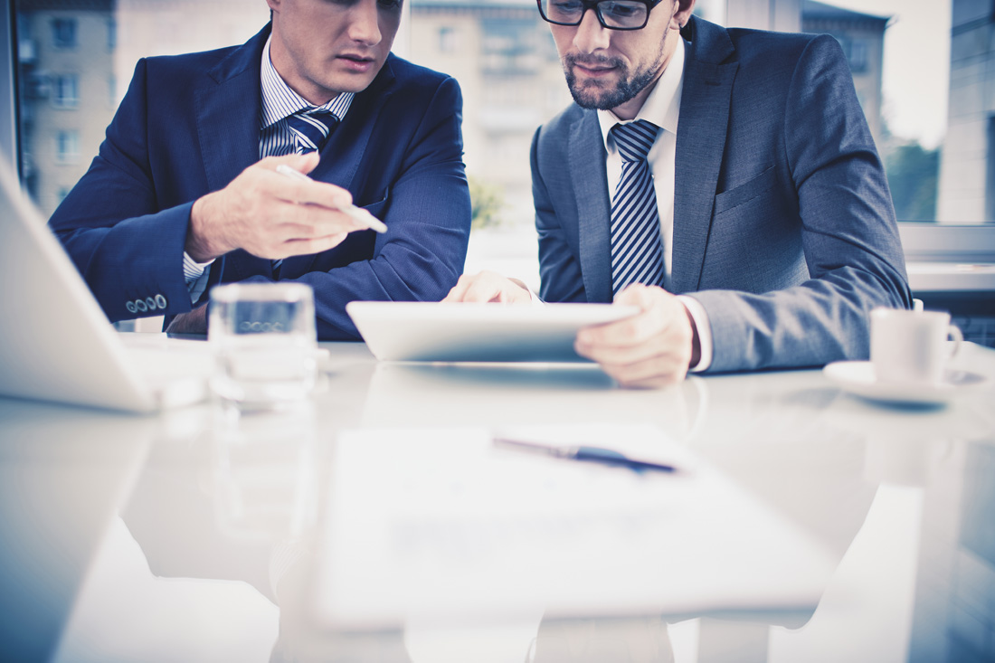 Two businessmen looking at tablet together