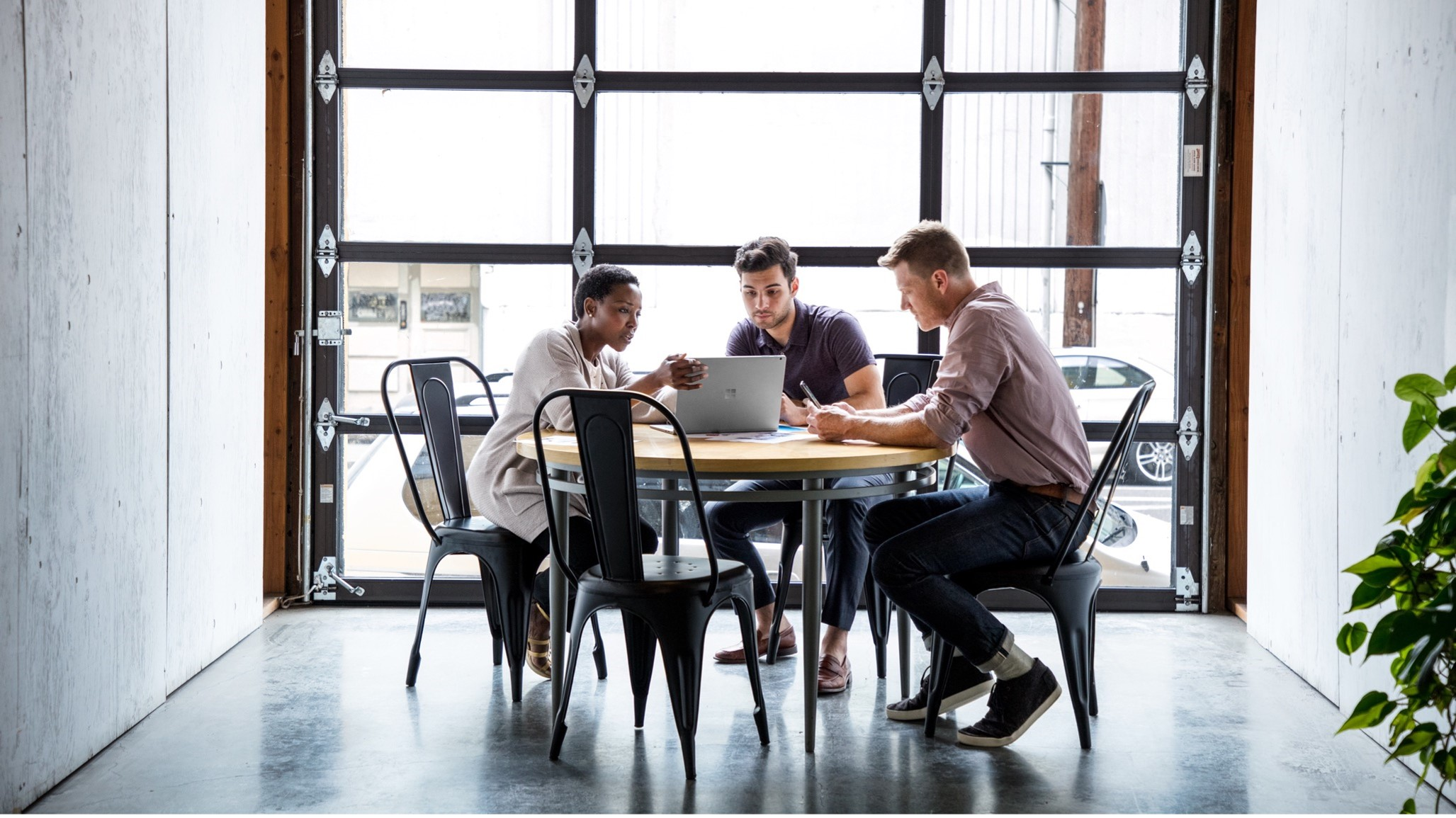 Three work colleague at a table in modern office
