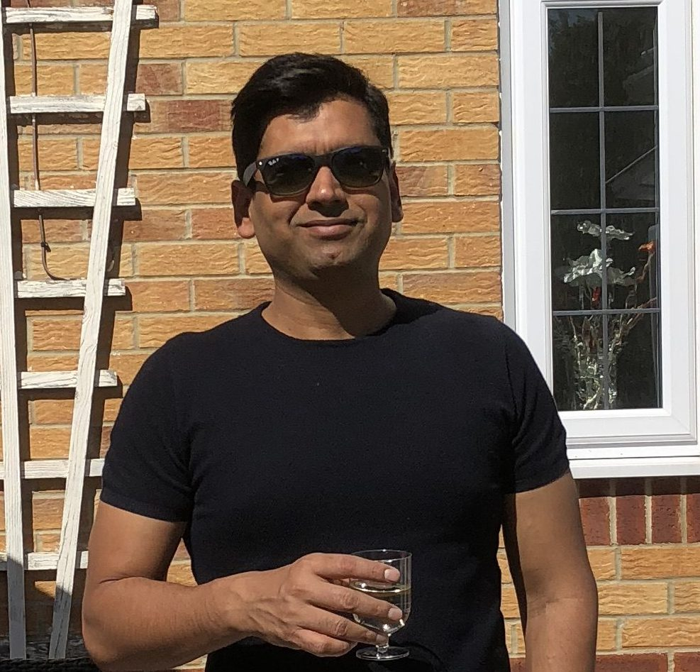Man in sun glasses holding a drink