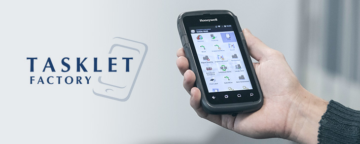 Tasklet factory image with man holding mobile device