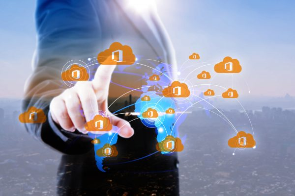 Business man tapping on virtual screen of world map
