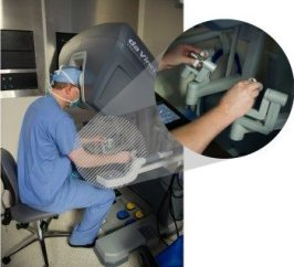 Dr. Guy at console of surgical robot repairing a mitral valve.