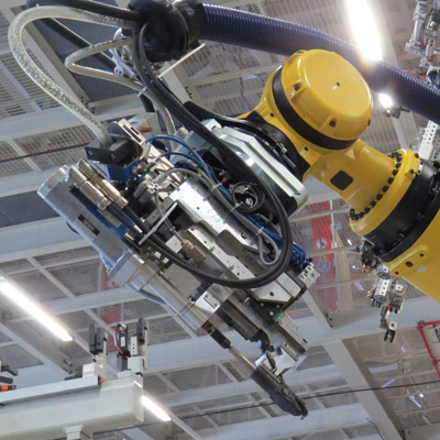 Electric cars will change the way industrial robots are used in manufacturing, says Fanuc boss