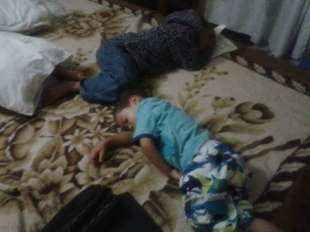 boys sleeping on the floor by rob rooker