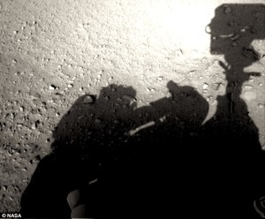 See the rover's shadow and, right next to it, the shadow of a man in a space suit