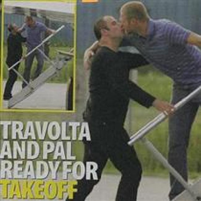 Scientology leader John Travolta secretly photographed kissing his homosexual lover (foto What does it mean)