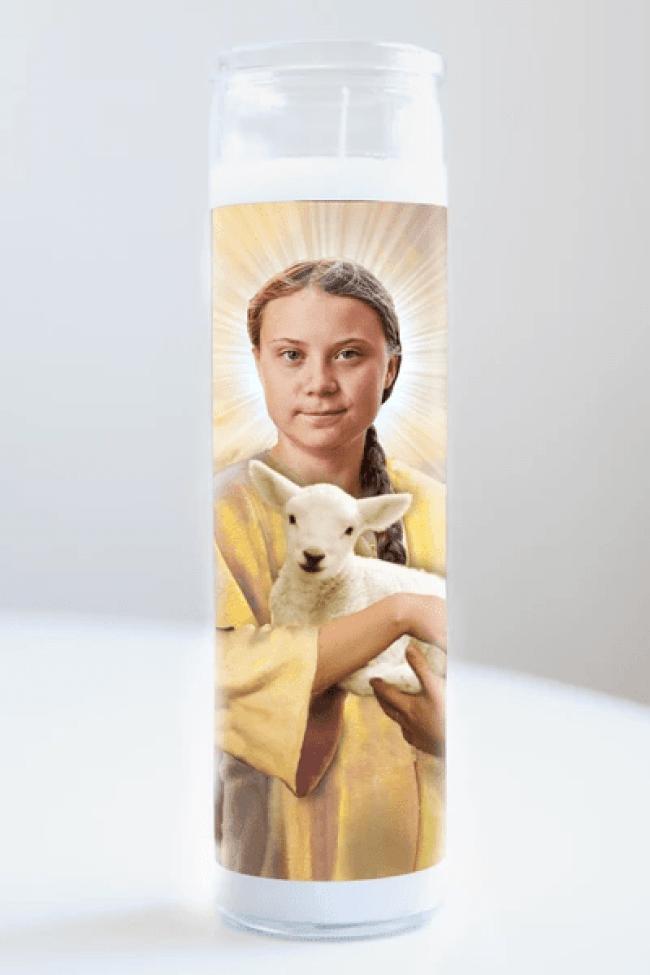 "Saint Greta Thunberg featured on Illuminidol's Texas-made 8"" prayer candle. The most divine way to bless any Thunberg disciple! (foto illuminidol)"