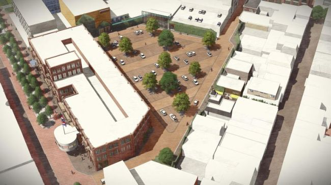 Links het oude V & D pand met daarachter het parkeerterrein, in het midden de Kerkstraat (foto Zeestad)