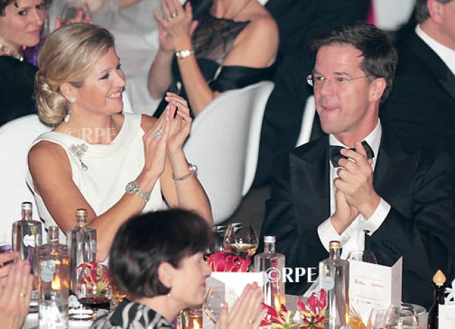 Princess Maxima with PM Mark Rutte Netherlands, THE HAGUE - JANUARY 23: Princess Maxima attends the celebration of 50th anniversary of the American Chamber of Commerce in The Netherlands at the city hall of The Hague. Photo: RPE-Albert Nieboer