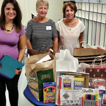 Members of the Wisconsin Club and After Schoolers Club donate bags of school supplies to Borman Elementary School.