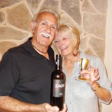 Wayne and Pam Casalino show off their winning wine and the traveling trophy for Tuesday Tasters.