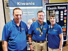 Dick Anderson with his wife Barbara receiving his Kiwanian of the Year award from Dave Everly, past-president of Kiwanis.