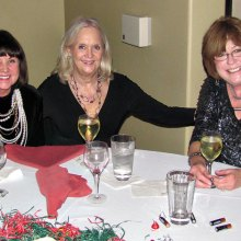 Cheri Hamilton, Ginny Brady and Maureen Schreiber shared champagne and their Christmas wish lists at the table.