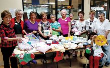 The volunteers for Operation Shower and some of the items they made.