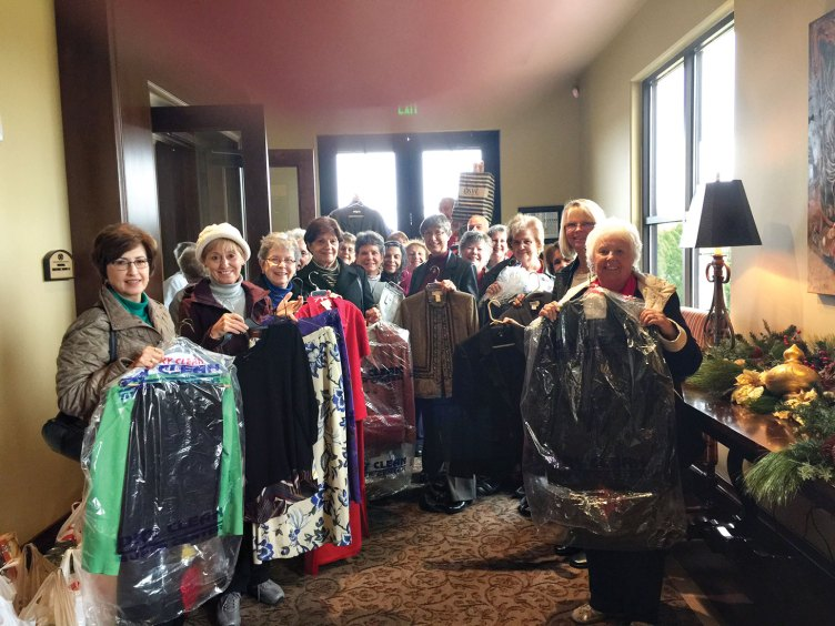 The After Schoolers with some of the clothing donations