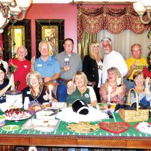Football Fans, sitting: Pete Toppan, Kathy Heberlein, Edie Jones, Kathy Zumann, Susan Parker, Melodye Rogers, Vickie Bone and Nancy Toppan; standing: Ed Heberlein, Connie Bjella, Jere Bone, Ed Jones, David Parker, Patricia Moore, Henry Moore, Tom Zumann, Diane Ace, Bobby Rogers and Joseph Ace