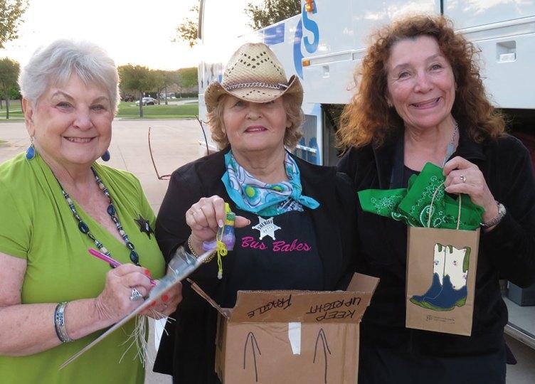 """Bus Babes"" Jan Utzman, Betty Gardner and Judy Ondina loading the bus"