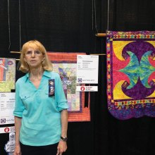 Judy Hilderbrand and her winning quilts
