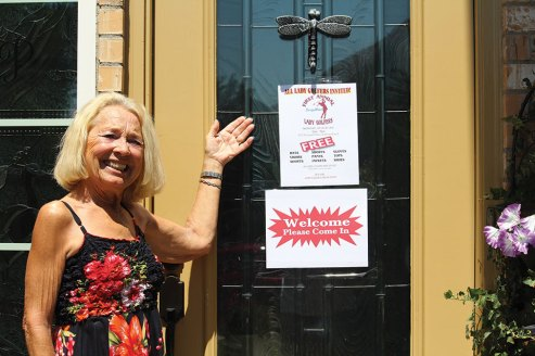 Mary Beninato displaying Victoria's welcome door