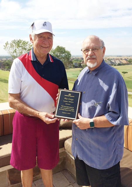 Newly elected 9MGA President Tom Prohaska presents retiring President Wesson Gage its 2017 Plaque of Appreciation.