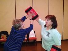 DPD instructor Rachel Fleming with resident Phyllis Neu.