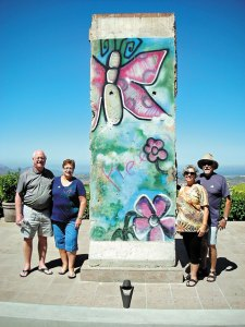 A piece of the Berlin Wall at the Reagan Library in Simi Valley. Left to right: Hap and Lynda Yoder, Jaine and Don Toth.